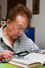 old lady man reading elderly magnifying glasses glass glassies