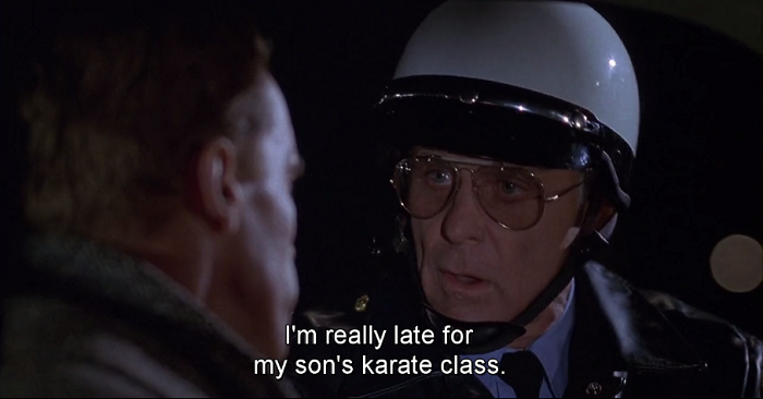 Robert Conrad cop jingle all the way movie screen cap arnold