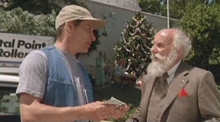 ernest the cab driver predictably picks up santa as a fare and of course immediately interacts with him while he is laying waste to anyone and everything - Ernest Saves Christmas